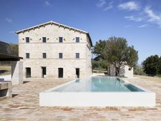 White pool. Wespi de Meuron. Stone house renovation in Treia. Italy © Hannes Henz