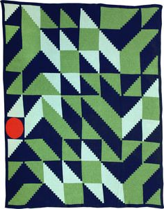 green and blue throw blanket with graphic patterns and bold color palettes