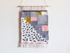 Wall weaving made with love. Perfect accent to an empty wall or nook in your home. Little lines are sewn on top to give the weaving a unique finish.