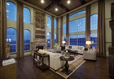 Contemporary Living Room with Ceiling fan, High ceiling, Arched window, Crown molding, Chair rail, stone fireplace