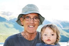Senior Man Smiling with Grandchild royalty-free stock photo Interracial Marriage, Smiling Man, Senior Year, Grandchildren, Home Art, Royalty Free Stock Photos, Framed Prints, Smile, People