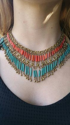 This 1960s statement necklace was a probably a souvenir from India. The orange and turquoise beads are made from clay. The necklace is in excellent condition. It is super fun and looks fantastic with an all white or all black outfit. A unique statement piece.