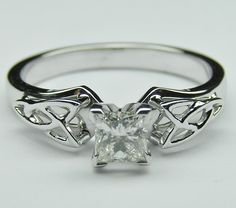 Princess Diamond Triquetra Celtic Engagement Ring. I love this!!
