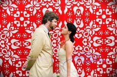 In the day of photo booths galore, it's not enough to just have a plain black background screen and let people take photos of… just themselves. YOU'VE GOT TO SPICE IT UPA LITTLE! Many photo booths have patterned backdrops to choose from.