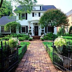 Brick walkway, iron fence, boxwoods Design Chic~MondayMusings: Front Porch Plantings