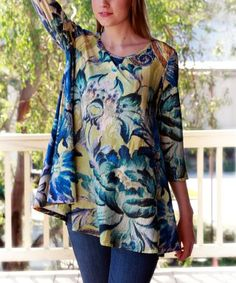 Make a statement in this boldly printed tunic that features a chic, high neckline and bell sleeves for balance and intrigue. Note: Due to the manner in which fabric is cut, pattern layouts may vary.Shipping note: This item is made to order. Allow extra time for your special find to ship.