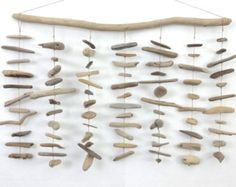 wall mobile sculpture or centre piece in linear hanging structures, conformity out of nature