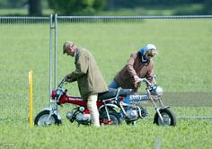 Prince Philip The Duke Of Edinburgh And Lady Penny Romsey Mount Their Mini Motorbikes During Royal Windsor Horse Show At Home Park Castle On