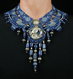 Barbara Natoli Witt  ~  Collar with Chimu silver ceremonial tweezers and button as centerpieces, pre-Columbian beads of sodalite, gold and silver, additional beads of kinite - tapestry patterns of birds and fish from ancient Peruvian weavings