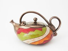 You are bidding on unique teapot.    This teapot ishandmade in small art pottery studio in eastern europe.    Made of black clay and hand carved