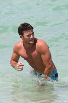 Pin for Later: Scott Eastwood Does His Best Baywatch Impression as He Goes For a Shirtless Run in Miami