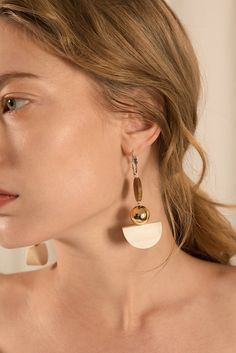 The Venn, a pair of wood and gold drop earring. Post back. Sold as a set.