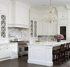 Notice marble, bar side finish, chandelier, hite kitchen image | White is timeless, it will never go out of style