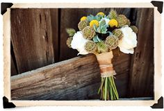 bouquet close up...great rustic wedding colors. would look great with yellow bridesmaid dresses