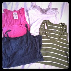 """**2 FOR $6  Bundle of tank tops!! Pink Hollister size S, """"oatmeal"""" colored Hollister size M (but fits like a small) with lace around the edges, gray Victoria's Secret PINK size S, and Maurice's size S green and white striped. The oatmeal and gray tanks have the built-in cami type banded top. The only thing wrong is a little bit of the lace is coming apart from the bottom in the oatmeal tank. See pic. Not noticeable, I just pulled apart so you could see. Hollister Tops Tank Tops"""