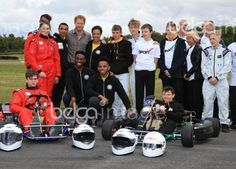 Britain's Prince Harry (5th L) poses for a group photo with members of The Blair Project at Three Sisters Racing Circuit in Wigan, north west England on July 5, 2016. Prince Harry joins school children with special educational needs or disabilities, as they become the first in the country to race their own computer designed race karts using new 3D printing and digital manufacturing technologies.<br />Clint Hughes / POOL / AFP