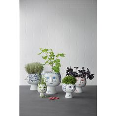 Invite the genuine joy of colours into your home with the green, long-necked Juliane pot plant holder on its base. #bjørnwiinblad