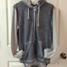 Ocean Drive hoodie Ocean Drive light weight zip front hi-low hem hoodie. Sleeves, drawstrings & inside of hood  are lighter textured gray and body is a darker gray. Full zip, front pockets, trendy hi-low hem. Brand new with tags! Size M. Please ask any questions prior to purchasing. No flaws. Thank you! Ocean Drive Tops Sweatshirts & Hoodies