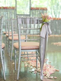 Chair décor is one of the most overlooked details when you think about wedding décor. But with the right embellishments, wedding chair decorations are sure to create a dramatic look for your special day. Chair Ties, Chair Sashes, Wedding Chair Decorations, Wedding Chairs, Bodas Boho Chic, Photos Booth, Chiavari Chairs, Diy Wedding, Ribbon Wedding