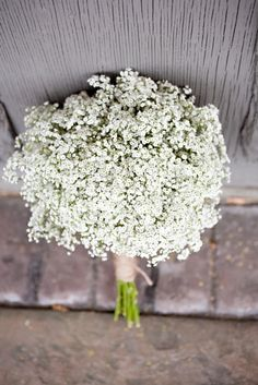 Baby's breath bridesmaid's bouquets tied w/twine.