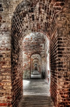 The inner corridor in Fort Macon, a five-sided fort constructed of brick and stone in 1826. Fort Macon was used by Union forces during the Civil War, and again during the Spanish-American War. The fort is now a part of the Fort Macon State Park in Carteret County, North Carolina.