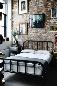 industrial bedroom, mix match, brick wall, vintage bed, gallery wall