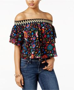 GUESS Printed Off-The-Shoulder Top  GUESS achieves a modern Boho look with vivacious off-the-shoulder detailing featuring zigzag embroidery along the neckline. Peppy ruffles give each sleeve a tiered silhouette.
