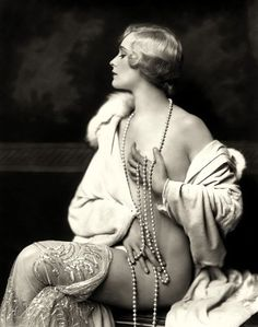 Fur, pearls, sequins  Photographer unknown.