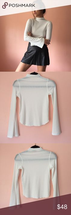 Zara Mock Textured LS Knit Get serious in this thin textured top by Zara. Features a mock neck, bell sleeves, tight to the body silhouette in thin, textured white knit. Wear tucked into high waisted denim. Fits true to size small. No returns allowed. Please ask all questions before buying. #zara Zara Tops Tees - Long Sleeve