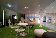 Interior. Contemporary And Sumptuous Conference Room Designs. Decoration Natural Nuance White Conference Room Wall Decor Feature Green Carpet And Freestanding White Stainless Round Tall Table Plus Steel White Freestanding Four Chairs