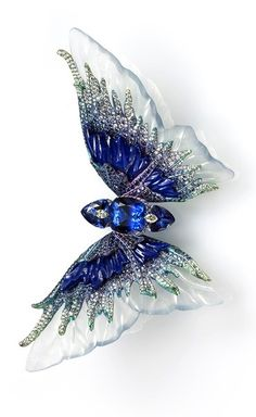 Wallace Chan brooch from the Fluttery series. This one is called Whimsical Blue. The body is made up of three Tanzanites set with Diamonds, and the wings consist of carved icy Jadeite, Lapis Lazuli and Sapphire. I want this it would look amazing in my hair trick to make brooches stay in place is a small piece of cardboard to secure in place
