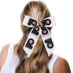 You have your game day outfit out and it looks amazing! You'll be covered head to toe in Philadelphia colors, but you know there's one last piece you've forgotten to add. This Cheer hair tie is just that extra bit of lovely team spirit you wanted to complete the total look. It boasts Flyers graphics printed on a pre-tied bow that attaches with a corded band for a secure fit for Philadelphia pride!