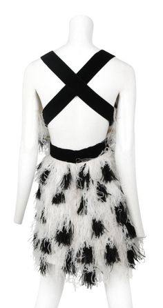 BILL BLASS 1990s | Black and White spotted marabou feather cocktail dress by Bill Blass. Deep open back with criss cross velvet straps and waist band. Each row of feather is hand sewn for easy cleaning.