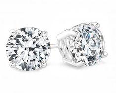 6 Carat round diamond studs earrings SI F