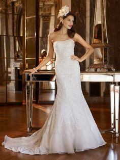 Here's my wedding dress! Crazy how different it looks on a skinny model. :) photo of Galina Signature SWG400