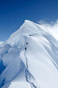 Climbers ascend the summit mushroom of Nevado Chopicalqui, Peru.  Alexandre Buisse Photography