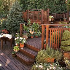 Back deck ideas offset lower step area to make room for planters or bench..