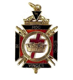 The reverse of an American gold, diamond and enamel Masonic Scottish Rite, York Rite and Knights Templar watch fob, c.1920; featured is a Maltese cross, crown and sword and the 'In Hoc Signo Vinces'/'In This Sign, Victory' legend of the Knights Templar. (Kensington House Antiques/collectorsnet)