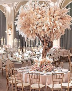Luxe Bohemian Wedding at the Beverly Hills Hotel. Floral Design by Empty Vase Florist – Pillar Candles İdeas. Grass Decor, Beverly Hills Hotel, Design Floral, Floral Centerpieces, Feather Wedding Centerpieces, Wedding Flowers, Wedding Table, Decor Wedding, Crystal Wedding Decor