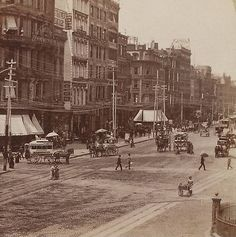 New York City - street scene of 14th Street, with telegraph poles and wires. Also pedestrians, horse-drawn carriages, and pushcart vendors. During America's Gilded Age era, c.1870s.  ~ {cwl} ~~ (Image: Insulators Blog)