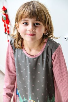See my last pattern and tutorial on how to sew girl's dress using a fabric panel.