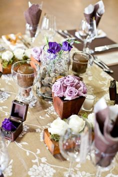Mix 'n Match is really in vogue at the moment!  Rather than opting for one centerpiece, fill your tables with a mix of smaller, beautiful pieces.