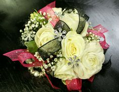 Pink, black, and bling! How cute is this prom corsage? #promflowersrowlett #2floristgirls