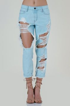 c69500dca46 Casual mid rise straight leg jeans with heavy distressing throughout the  front. 5 pocket design with button and zip closure. - Cotton - Imported -  Model is ...