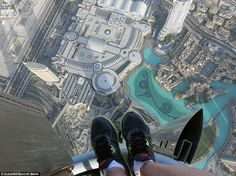 The photographer includes his feet in a shot while phtographing Dubai for the unique project that includes 360-degree panoramic timelapse