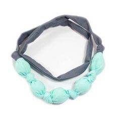 A rubber filled fabric necklace perfect for a teething baby and the versatile mom life. Approx. 24 inches, just enough to fit over your head and short enough to stay out of your nursing baby's way!Whether you use it while nursing, or to keep your baby entertained, you'll love the versatility and convenience each necklace comes with. Durable to be chewed, pulled, and thrown in the wash! Lay it flat to dry and repeat!**Because all products are made to order, please allow...