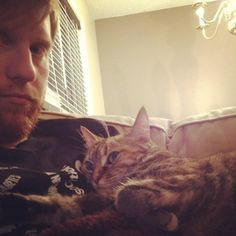 thedailybeard:  cycling-ginger:  Hangin out watching Netflix on the couch  #bestfriends #meow #ocicat (Taken with instagram)  kitties or gtfo.   BEARDS n' KITTIES or GTFO