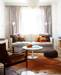 Neutral living room with modern lights and coffee table