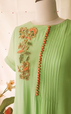 Best 12 Beautiful French knots and Zardozi Handwork on front Fine pintucks detail on one side at front A-line relaxed fit with elbow length sleeves – SkillOfKing. Neck Designs For Suits, Sleeves Designs For Dresses, Neckline Designs, Dress Neck Designs, Stylish Dress Designs, Stylish Dresses, Blouse Designs, Sleeve Designs For Kurtis, Casual Dresses
