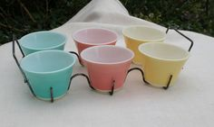 Set of six JAJ (English Pyrex) bowls in a metal carrier.